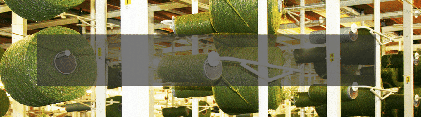 artificial grass yarns on a roll in factory