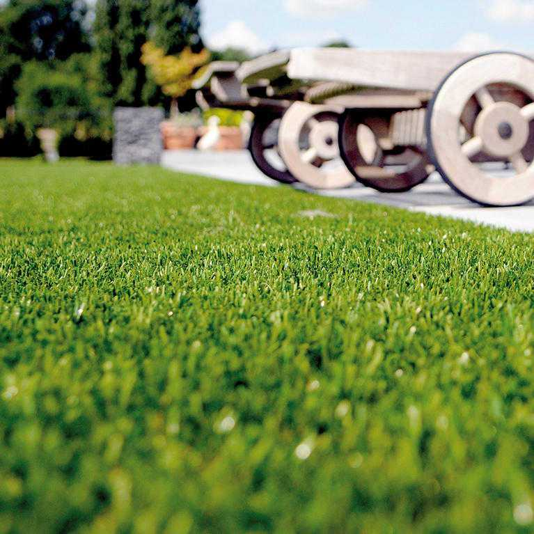 bright artificial grass laid by patio