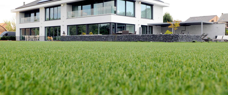 dense fake grass laid at a modern house
