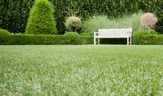 white bench on artificial grass