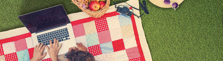 couple having picnic on artificial grass