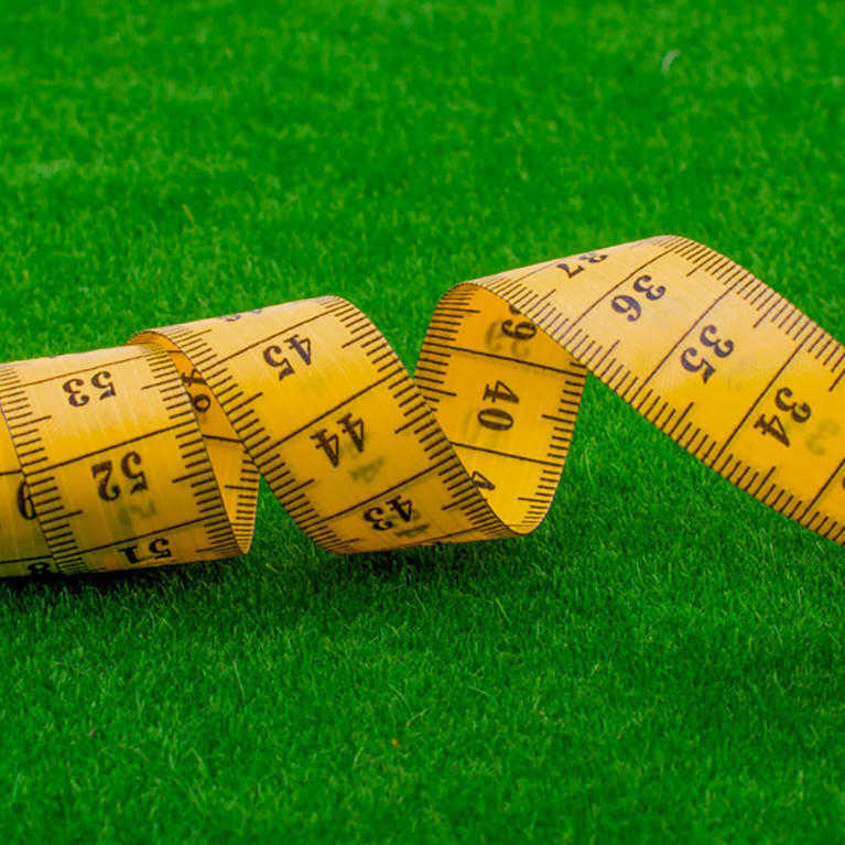 tape measure measuring artificial grass