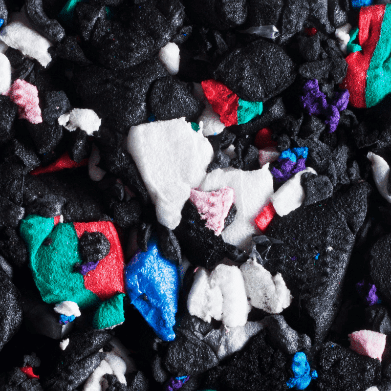 Close up of black, white, green, blue and red colours in shock pad for underneath artificial grass